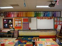 Packed classroom: especially like her word wall & DIY chair pockets