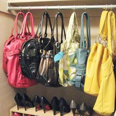 organize handbags and purses in closet using shower curtain hooks!