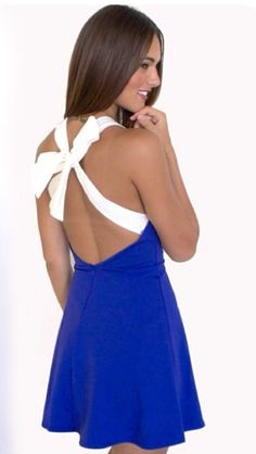 Love the pretty bow on the back of this dress