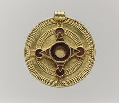 Pendant  Date: early 7th century Culture: Anglo-Saxon Medium: Gold, garnets with patterned foil backings