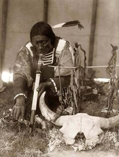 "Sioux Indian with his pipe and the Great Mystery or ""Wakantanka"" a pipe ceremony"