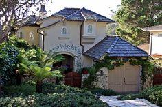 Delightful Mediterranean Cottage in Carmel, California - Love the trompe l'oeil blue-flowering vine growing over the entryway...
