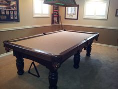 Older Dufferin dark oak pool table with a light taupe cloth colour