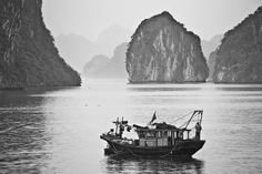 Fishing the waters of Halong Bay. Image by Peter Barrien. #beautifulworld http://www.lonelyplanet.com/photocomp?lpaffil=soc_pi_p_o_bw