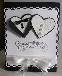 cute black and white bride and groom hearts w/white satin ribbon