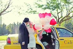 heart shaped balloons and yellow cab