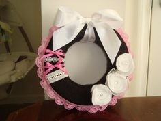 Yarn wreath / Pink and Black with lace. $8.00, via Etsy.