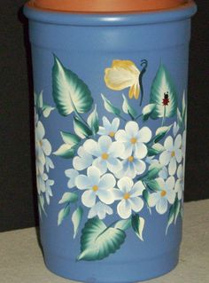 Clay vase painted using One Stroke painting method.