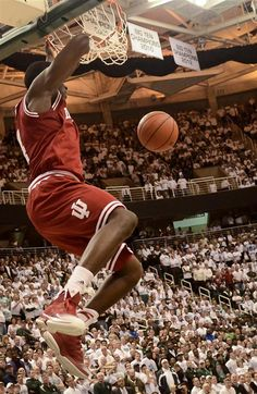 Junior guard Victor Oladipo hangs off the basket after completing a dunk toward the end of the second half of IU's 72-68 win against Michigan State on Tuesday at Breslin Center.   Indiana Daily Student