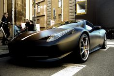 I'd hate to try and keep it clean, but you can't deny it looks gorgeous.    Matte Black Ferrari 458 Italia