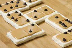 Peanut Butter Dominoes   White bread domino tiles withSmooth Operator peanut butter and mini chocolate chip dots.  Conceived By Lee ZalbenPhotography By Andrea Hernandez