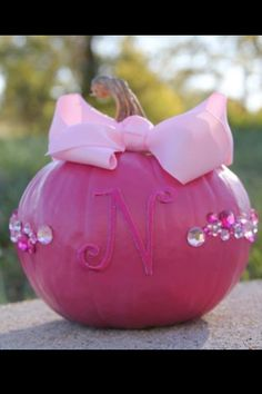 Pink Pumpkin craft for October Princess Parties. Buy small pumpkins. Paint them pink ahead of time and glue on the pink bow. You can buy felt letters for each girl and put on her pumpkin. Girls decorate with press on jewels.