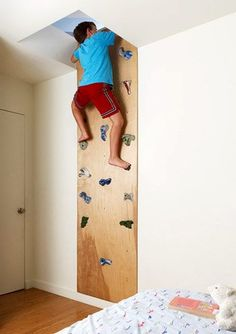 Coolest parents ever ~~ Rock wall lead to   a secret play space above the rooms. There is an entrance from each kid's room   to the shared space.