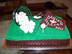 Tee Time! - Double layered chocolate sheet cake filled and covered with chocolate fudge icing,  I piped on chocolate buttercream turf and made some solid white chocolate golf balls and golf tee.  I made some modeling chocolate and colored it A maroon to make the golf flag as the couple both graduated from there.  The golf shoe is solid chocolate and was ordered for the cake, along with the real golf range basket.