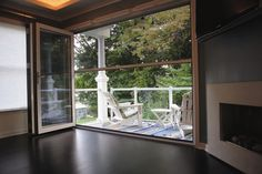 Sun room on pinterest enclosed patio four seasons room for Pull down retractable screen door
