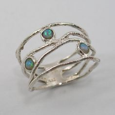 Opal and sterling silver wavy ring