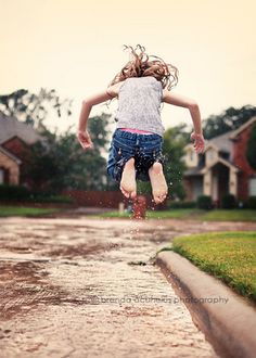 Love kids in the rain photos. And my boys love jumping in puddles. brenda acuncius