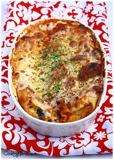 Spinach Manicotti by The Cooking Bride.  Manicotti stuffed with spinach and ricotta cheese and topped with tomato sauce, soft mozzarella, and Parmesan cheese.  Can be made ahead of time.  Freezing instructions included.