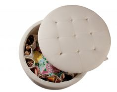 Ottoman by Lilly Pulitzer holds 16 pairs of shoes & has room for purses in the middle.