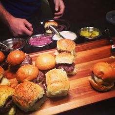 Slider bar with chipotle ketchup, pickled onions, garlic aioli, Swiss ...