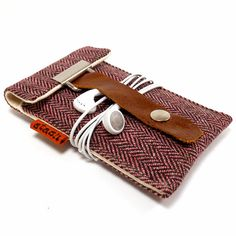 I love how Mari Forssell on Etsy created this case so that it also keeps your earphones wrapped together nicely.