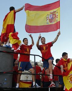 Spain's national soccer team players Sergio Ramos (R) and Jesus Navas celebrate their Euro 2012 victory on an open-top bus during a parade in downtown Madrid July 2, 2012.