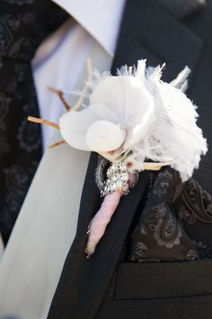 A fluffy white boutonniere.