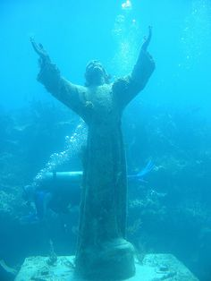 Christ of the Abyss, popular site for scuba divers and snorkelers, Key Largo, Florida, (this is the third statue of the Christ of the Abyss. It was presented to the Underwater Society of America in New York in 1962 and placed at its current location in 1965)