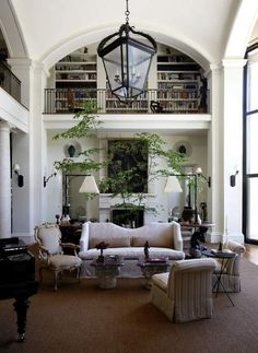 A second story hallway library that looks over the living room- lovely.