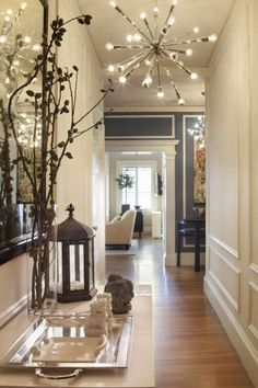 Chic and oh so pretty! Lighting makes all the difference, making this hallway sparkle!