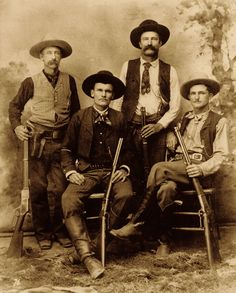 "This classic photo was taken either before or after the famous 1892 shoot-out in Shafter, Texas, where the Texas Rangers had been sent to protect a silver mine. (Standing, from left) Robert ""Bob"" Speaks and Jim Putman. (Seated, from left) Alonzo Van ""Lon"" Oden and John R. Hughes. Ira Aten had recommended Hughes to the Texas Rangers after Hughes ably assisted him in the 1886 pursuit of murderer Wes Colliers."