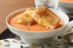 Tomato-Basil Soup with Grilled Cheese — Creamy, cheesy tomato basil soup tastes even better when it's served with America's favorite grilled sandwich, grilled cheese!