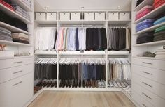 Custom Closet System - like how things aren't so segmented. Clothes are all hung together, looks more streamlined