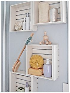 small crates used as shelves for bathroom storage or for  attaching to sides of vanity mirror to frame it out....hmmmm....