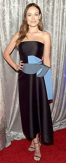 Olivia Wilde looked striking in a black dress by Roksanda featuring a bold blue and orange embellishment.