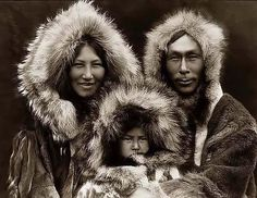 You are viewing an important image of an Eskimo Family Group. It was taken in 1929 by Edward S. Curtis.    The picture shows Three Eskimos posed.    We have created this collection of pictures primarily to serve as an easy to access educational tool. Contact curator@old-picture.com.    Image ID# A62DB214