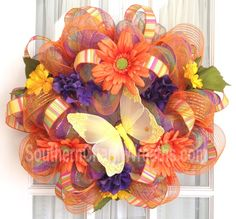 Bright Sunny Deco Mesh Wreath w orange, purple, lime green stripe mesh. #decomesh #wreaths