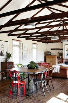 exposed beams + wood floor + mismatched chairs = <3