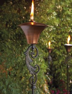 Boasting elegant scrolling lines and delicate details, the Legato Torch shines a glowing light on your outdoor space.