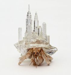 By Aki Inomata, quite literally taking the hermit crabs ability for carrying their home on their back, the Japanese artist crafts architecturally inspired shells from plastic for the crabs, with miniature cities on them. I think another fantastic aspect is the transparency, how you can see the anatomy of the crab even when they withdraw is just fascinating.