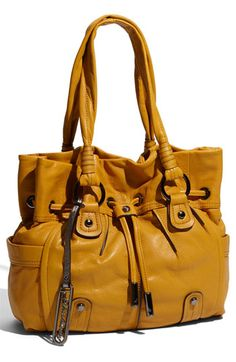 I love mustard yellow purses! :)