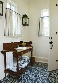 Love these curtains hung part way down the window on tiny rings.  Lantern light fixture super cute too! I think I like the black against white going on.  From Nine & Sixteen. To hide supplies in laundry room!