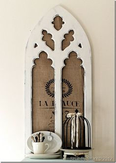 Love the old grain sack behind the gothic white frame! from shabby story: a beautiful pop of aqua…