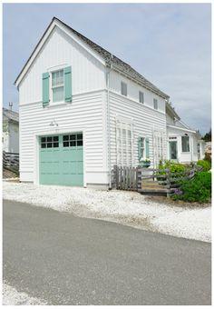 turquoise garage door and shutters