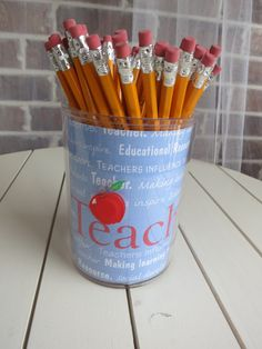 Acrylic Pencil Holder holds alot of pencils. There are 48 in this container.  Great Teacher Gift!  Selling for $20.00 Cash only buyer picks up - locals only.  The container is removable and you can re-design with a photo or other scrapbook paper.