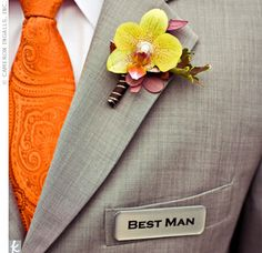 "From Melanie and Gavin's Orange and Yellow Outdoor Wedding:  The guys looked stylish in grey suits accented with orange ties for the groomsmen and a yellow one for the groom. They attached printed pins saying, ""groom,"" ""best man"" ..."