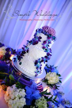 White & purple wedding cake with a cascade of purple dendrobiums!
