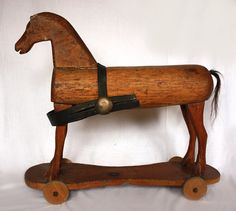 Antique early 1800's primitive French wooden rolling toy horse