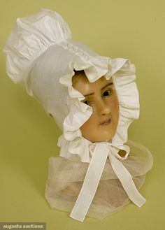 1800-1850. Tasha Tudor Historic Costume Collection. White tabby cotton, ruffled around face and neck, with very high, puffed crown, whitework eyelet insertion trim along center crown, long ties. 1820s, crowns, histor fashion, tallcrown bonnet, white tall, tasha tudor, 18151835, basic white, tall crown
