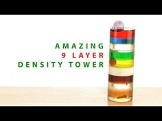 "Density Column ""With this trick, you'll put a new spin on our famous Density Column demonstration. First, we'll teach you how to make layers of liquid sit on top of each other. This density demonstration looks cool, but what if you could make different objects float in the middle of those cool looking liquids? You'll impress yourself and your friends with what you can do with your Density Tower."""